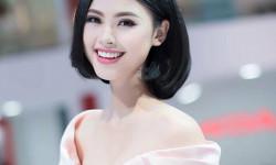 Top 5 Hoa hậu Việt Nam Đào Thị Hà khoe vai trần mướt mắt bên dòng xe sang